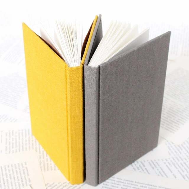 Handbound blank journals with linen covers by Paperiaarre