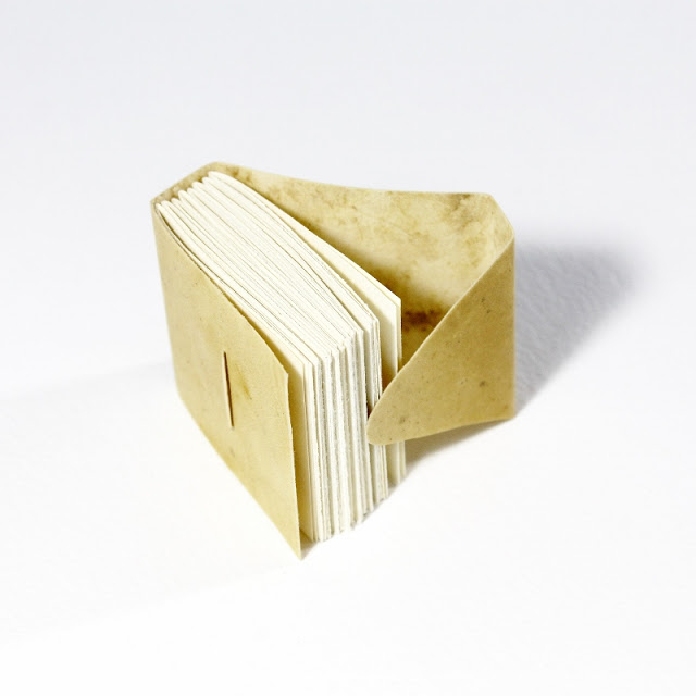 tiny link stitch binding with reindeer vellum covers - Kaija Rantakari / paperiaarre.com