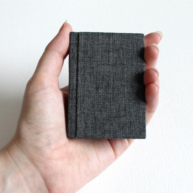vintage endpapers on mini notebooks - bound by Kaija Rantakari / paperiaarre.com