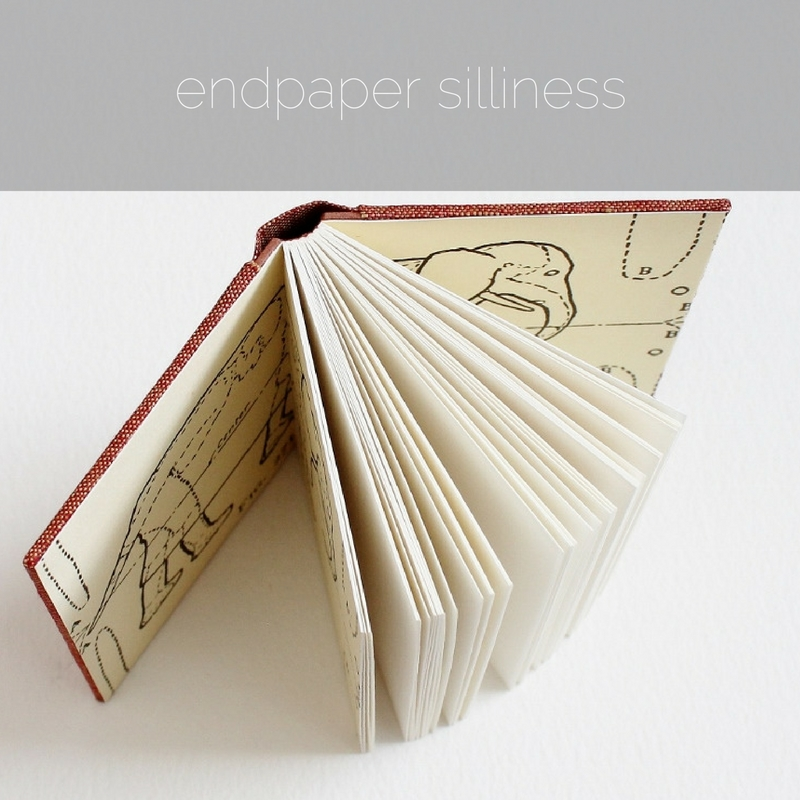 small sewn boards binding with silly elephant endpapers by Kaija Rantakari / paperiaarre.com