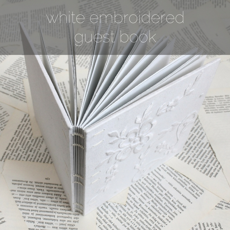 white embroidered Coptic bound guest book by Kaija Rantakari / paperiaarre.com