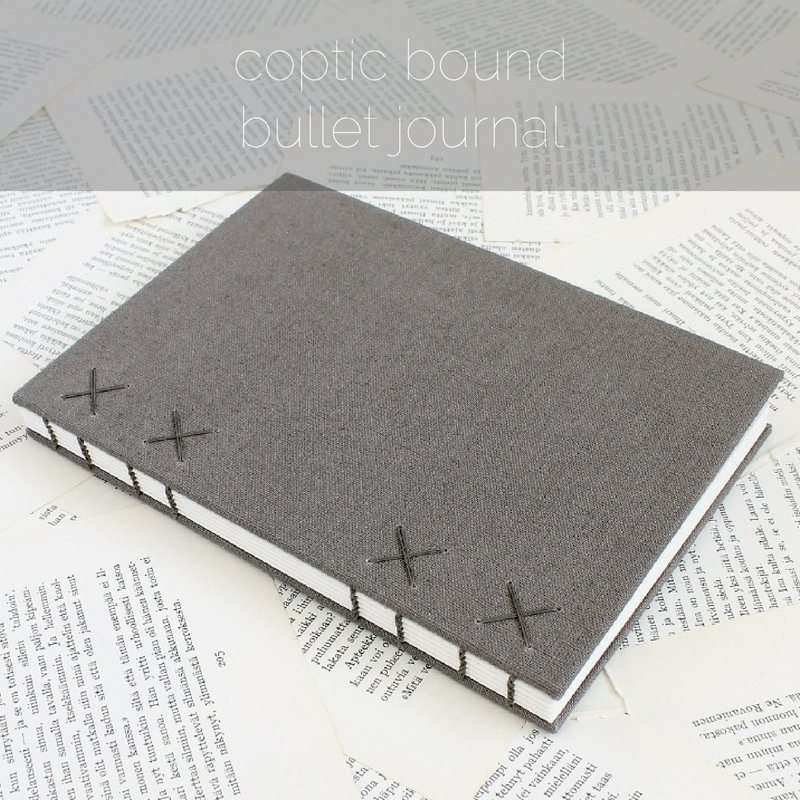 Coptic bound bullet journal in grey linen by Kaija Rantakari / paperiaarre.com