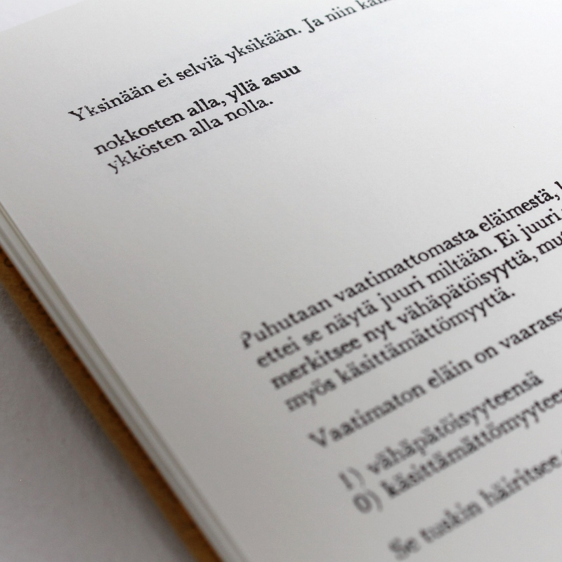 Sewn boards binding in fine goat skin by Kaija Rantakari, 2016. The binding features 768 binary code leather onlays and typed endpapers with the information of the title, author, and publisher of the book: Ontto harmaa by Olli-Pekka Tennilä, published by Poesia, 2016 - paperiaarre.com
