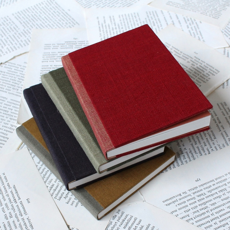 small handmade notebooks with linen covers, handmade by Kaija Rantakari - www.paperiaarre.com