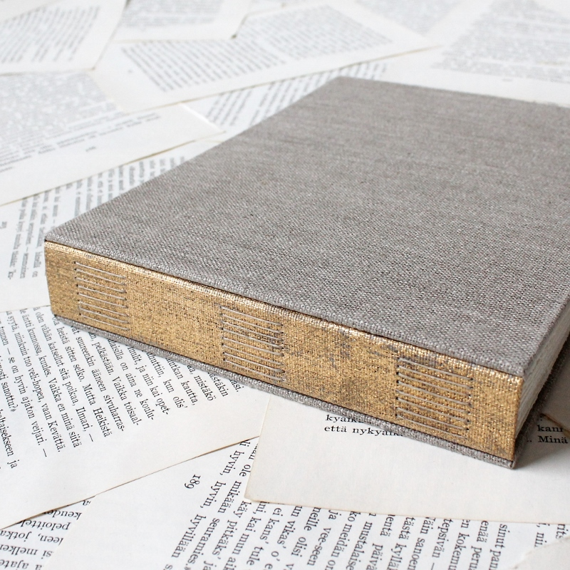 natural linen photo album with distressed gold spine by Kaija Rantakari / www.paperiaarre.com