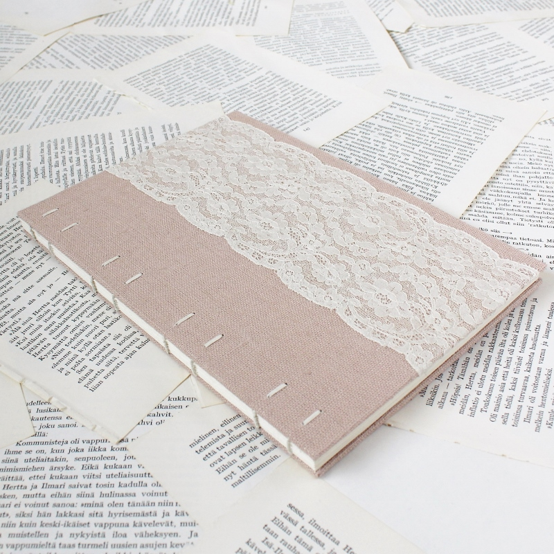 Coptic bound guestbook with blush pink linen and floral vintage lace - handmade by Kaija Rantakari / www.paperiaarre.com