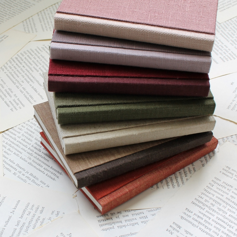 small handmade notebooks by Kaija Rantakari - sewn boards binding with linen / book cloth covers - www.paperiaarre.com