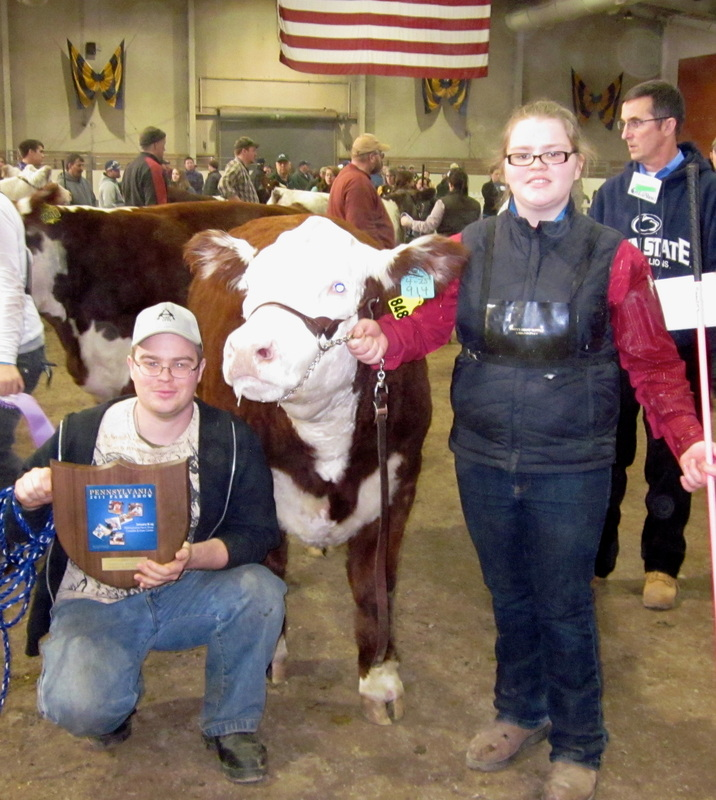 George IV and Emily at 2011 PA Farm Show after winning Champion Hereford Steer