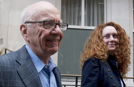 Priorities: Murdoch bankrolled his UK newspaper CEO Rebekah Brooks through her phone hacking and bribery trial, at which she was cleared