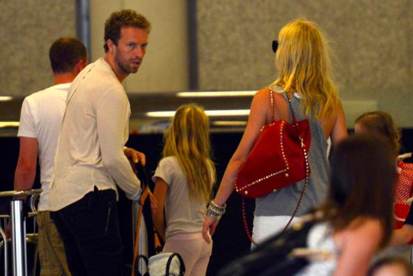 Chris Martin (l) and Gwyneth Paltrow (c) PA