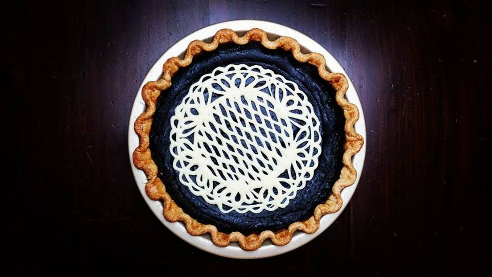 Cocoa Pumpkin Pie with white chocolate doily