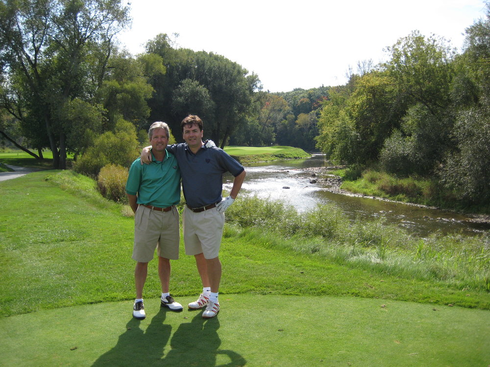 Clarke and me at the River course. I think there's a fisherman in the background who was in danger every time we teed off..