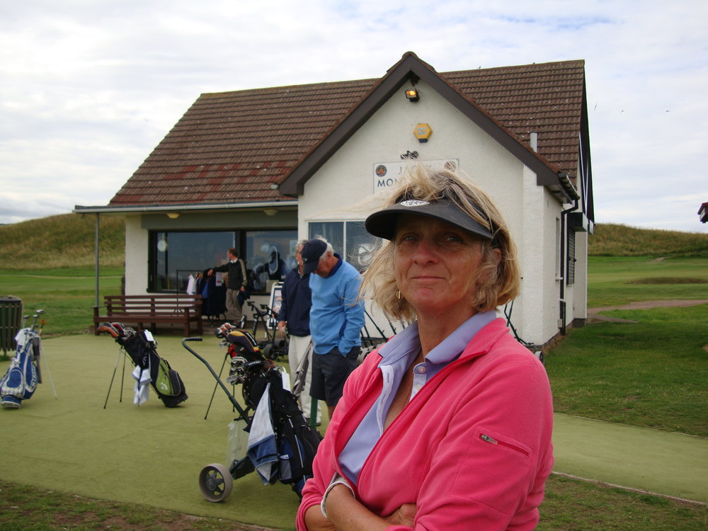 Gill waiting to tee off at the pro shop adjacent to the first tee. 2010.