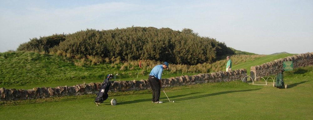 "Me at the famous 13th hole ""the Pit"". I'd like to say this is my second shot but ...."