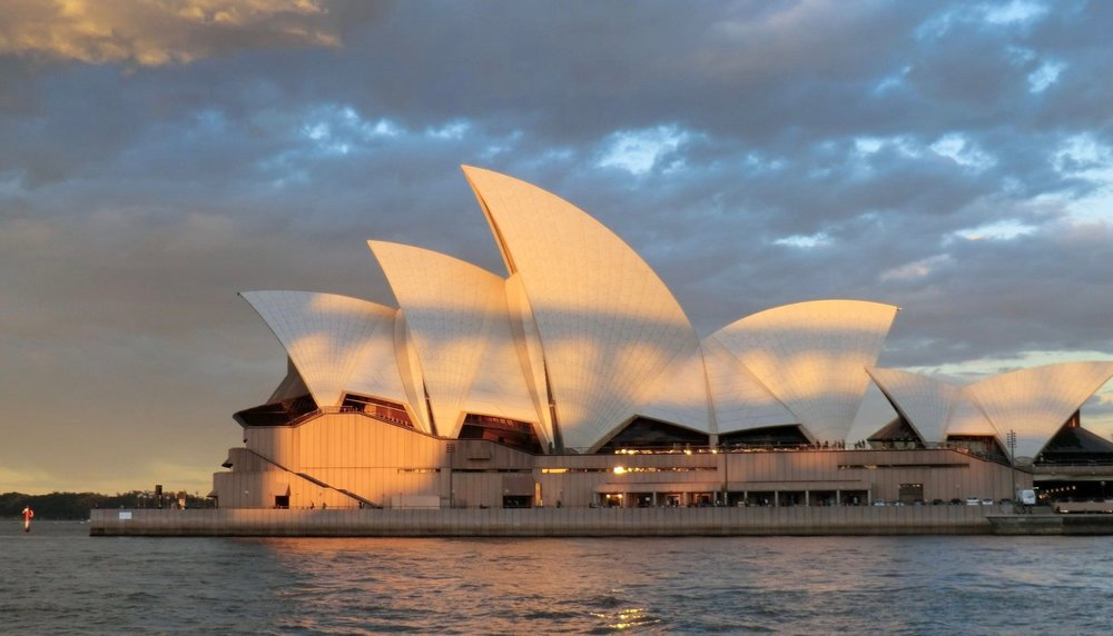 The iconic Opera House with the shadow of the harbor bridge:cool picture I think.