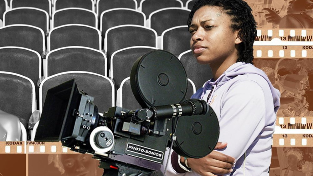 Black woman filmmaker outside