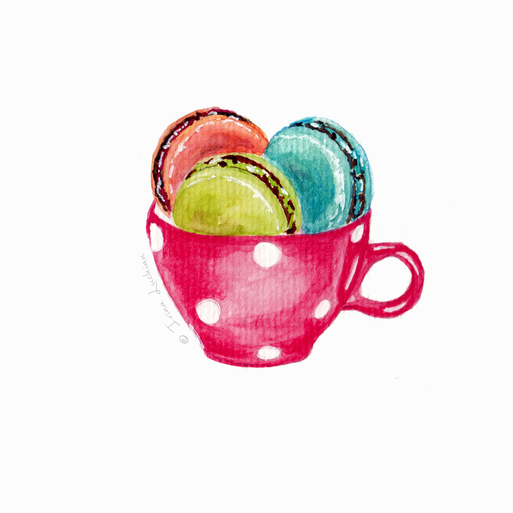 macarons in a polka dots tea cup