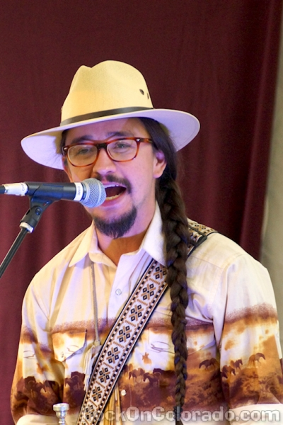 How did you get here? - For Joshua Randy Abeyta, of the Denver-based Chicano funk band Los Mocochetes, the answer to that question is as clear as it is complex. In this episode, Josh goes deep on how tragedy and wrong turns led him to a life dedicated serving his community through art.  His music blends influences ranging from East Coast hip-hop, midwest doo-wop, and southwest rancheras. Check out more music from Los Mochochetes here.