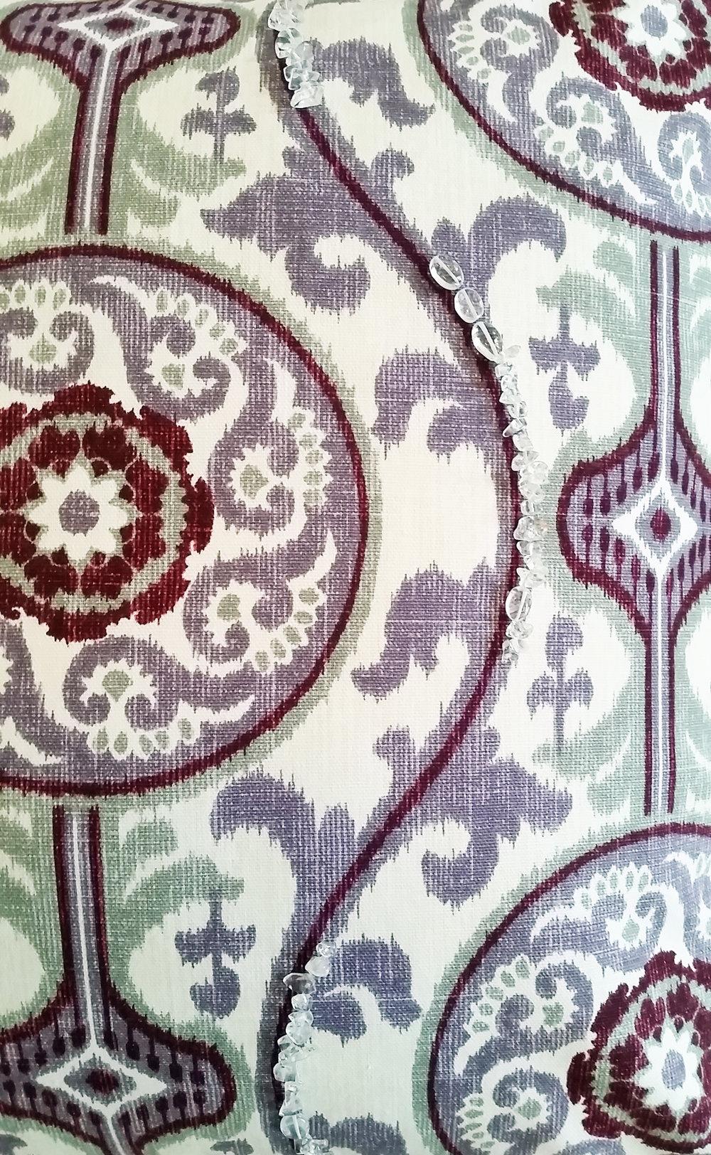 Damask print pillow with quartz crystal