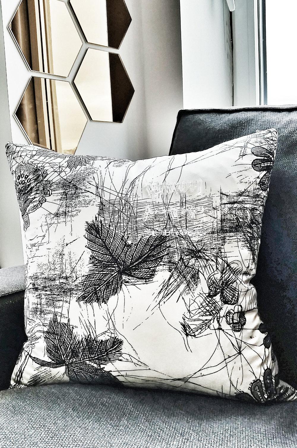 Designer silk pillow with raw quartz crystal