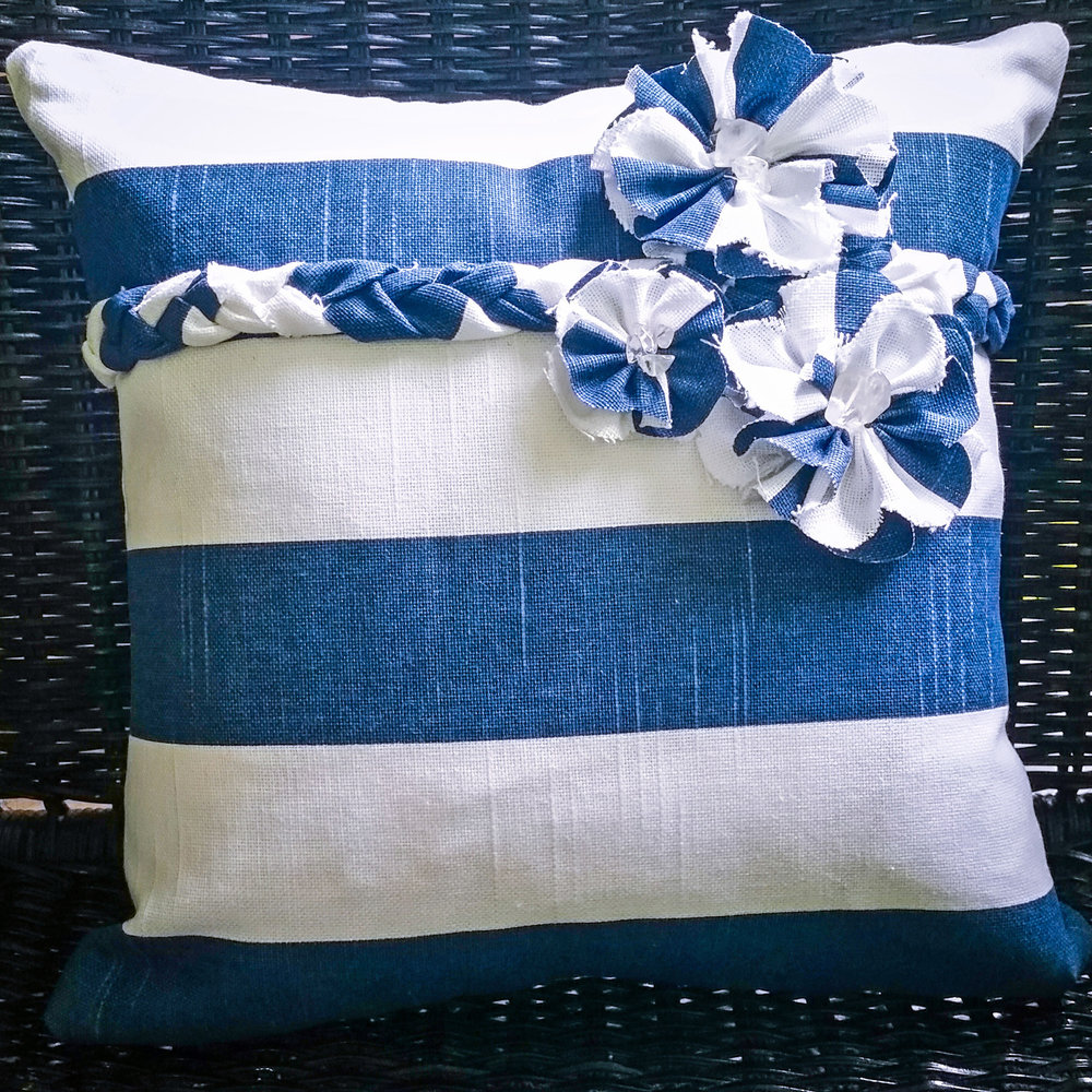 Blue and white pillow with flowers