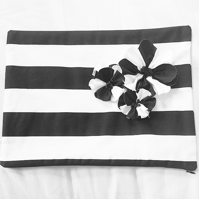 Black and white pillow with flowers