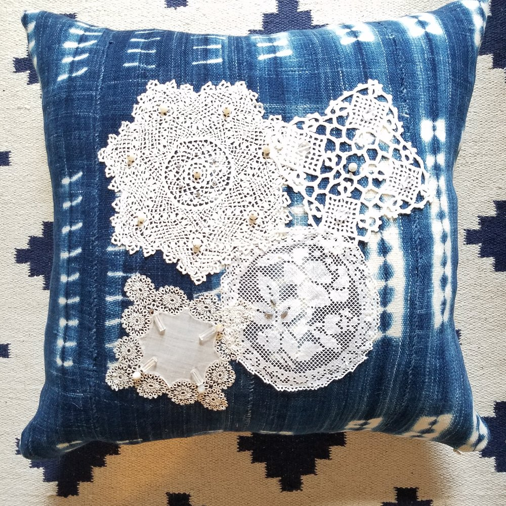 Indigo dyed pillow with antique lace and stones