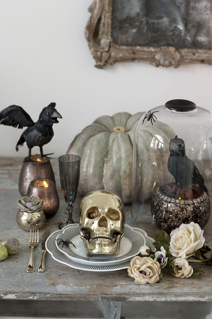 Having a dinner party?  Use gold skulls, dried or silk flowers, little spiders, and ravens with mercury glass to decorate your table.