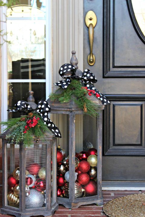 Don't want a wreath, use these wooden lanterns filled with ornaments to spruce up your front entrance.