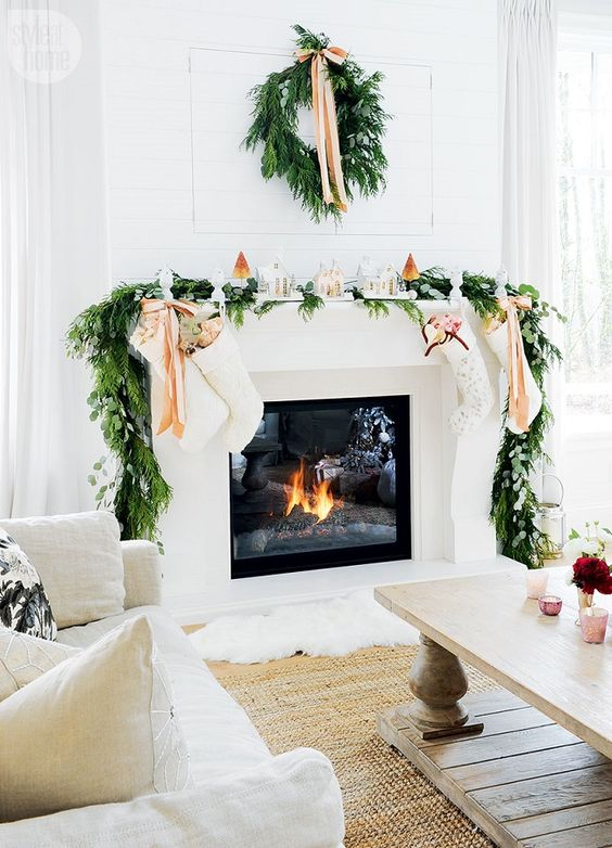 Love the white stockings and houses on the mantel.  This is so elegant.