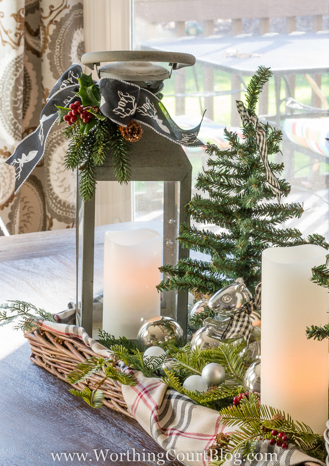 You can use lanterns for the table center pieces as well.  I also love the silver ornaments mixed in.
