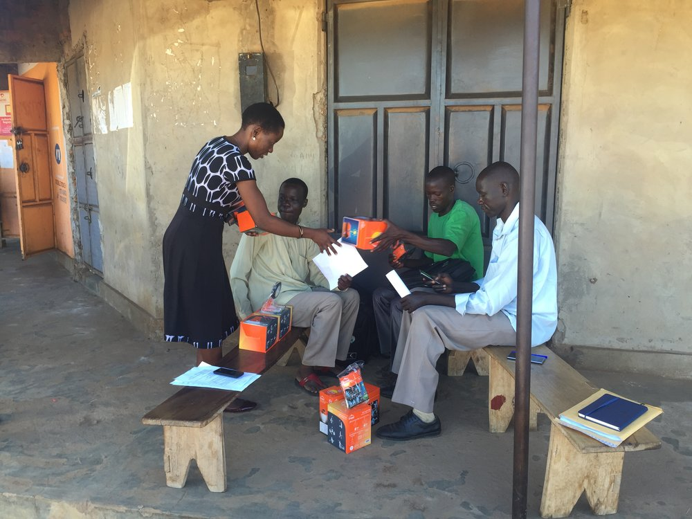 Ruth Omongole_Local Links Area Team Leader in Teso Region of Uganda meeting with her solar corps.jpg