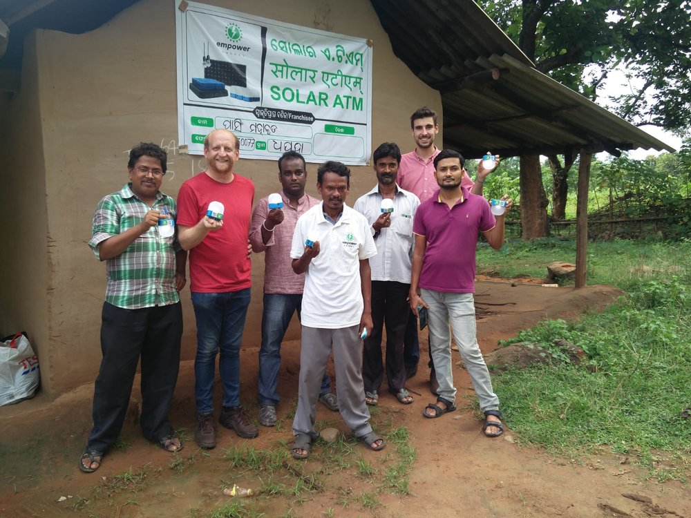 Second Franchisee Pasing Mahakud and Empower Team in front of Shop.jpg