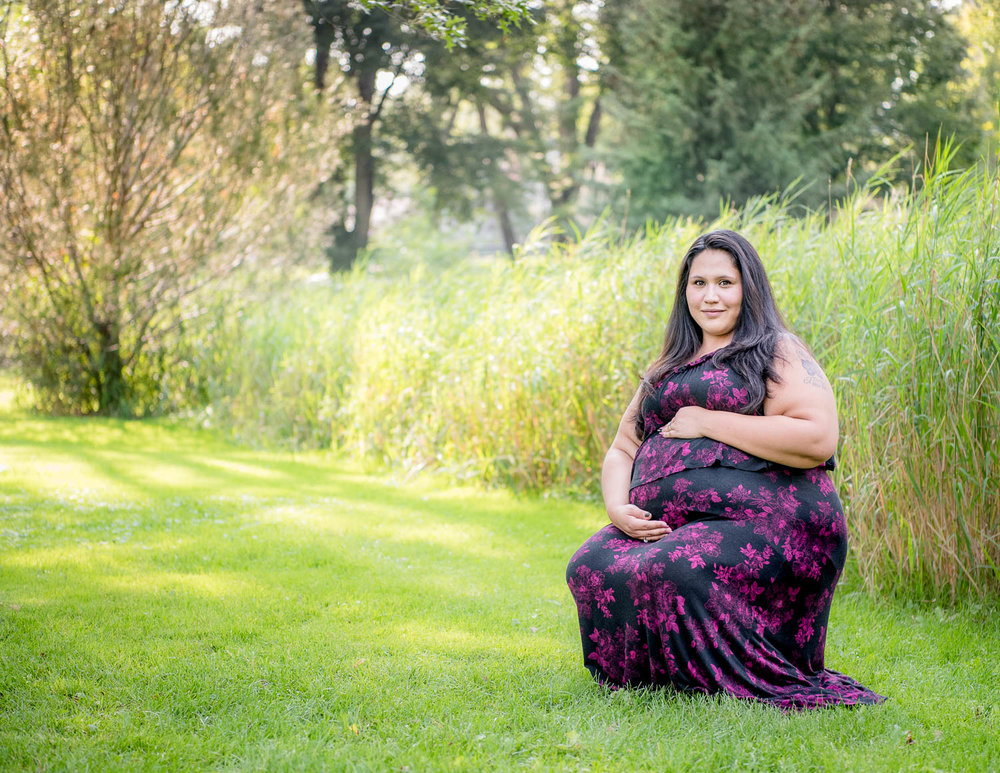 A beautiful pregnant mama in a beautiful park