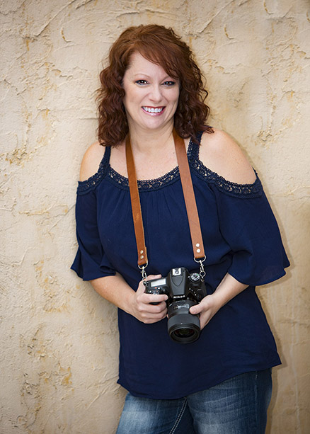 DeAnna Weyhrich Birth Photographer holder her camera