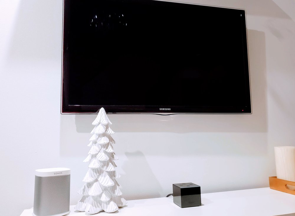 Connect Alexa To TV: Fire TV Cube Connected To TV. HDMI cord was routed through wall to TV.