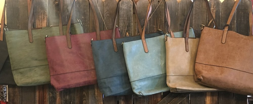 2-in-1 is the way to go - We have purses that fit every need and occasion. Our inventory is constantly changing so check in often to see the freshest styles. For the most up to date color selection head to Facebook or Instagram :)