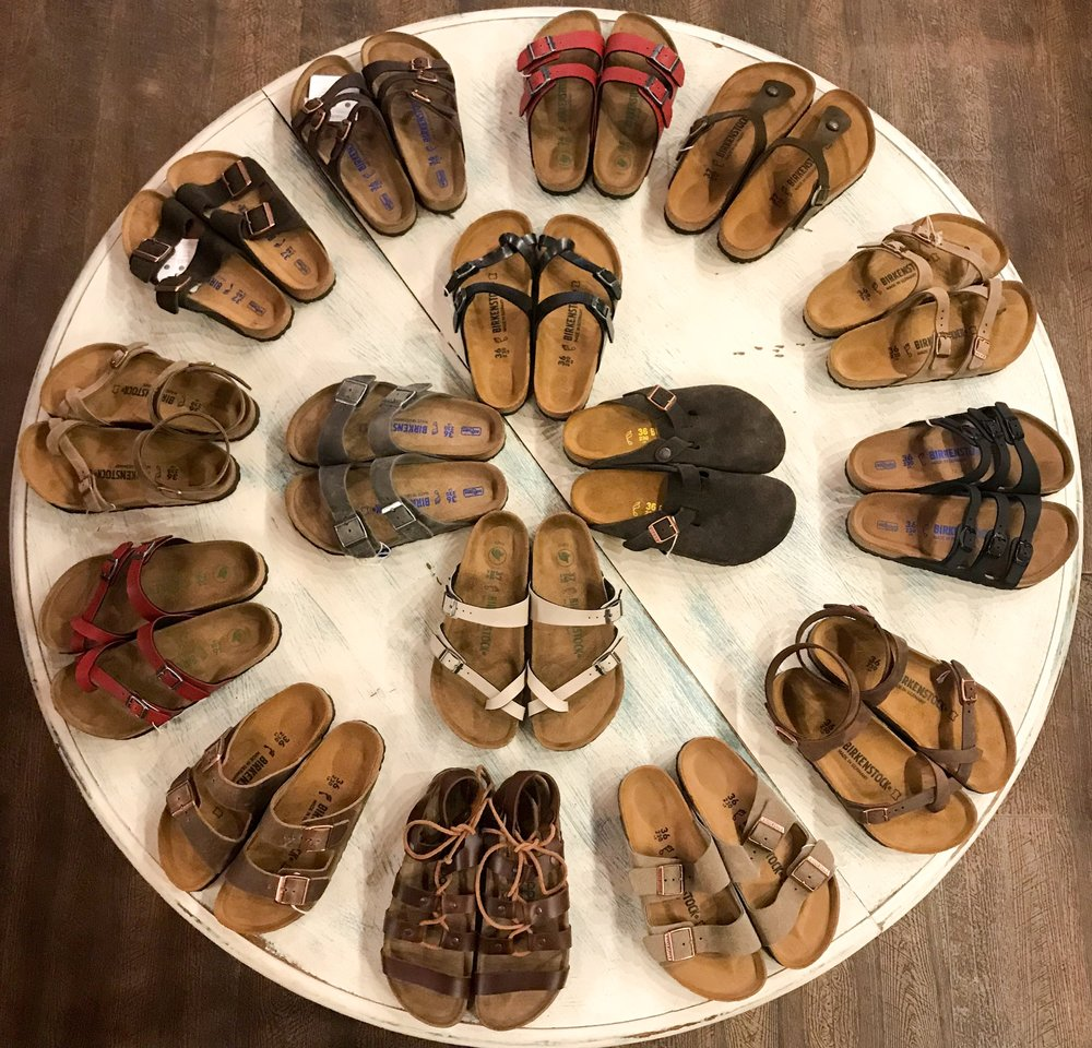 BIRKENSTOCK - Disclaimer! We have a HUGE selection of Birkenstock sandals! We receive and sell them faster than we can update our website. If you're looking for a certain style please call us 928-214-6355 and inquire! I am willing to bet that we have a Birk to make you happy:)The Birkenstock lineage dates back to 1774. Since then they have refined the definition of natural, premium quality shoes that promote good posture while looking clean and stylish.