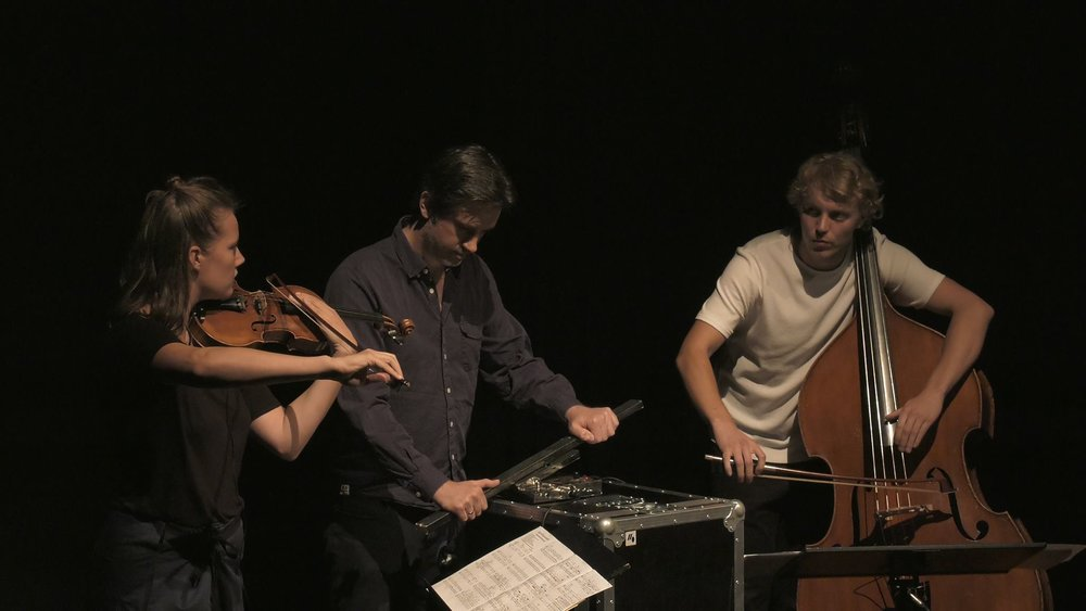 "Faculty member Simon Steen-Andersen performs his composition ""Study for String Instrument #2"" with festival participants at Musikhuset Aarhus.   —NMFS 2016"