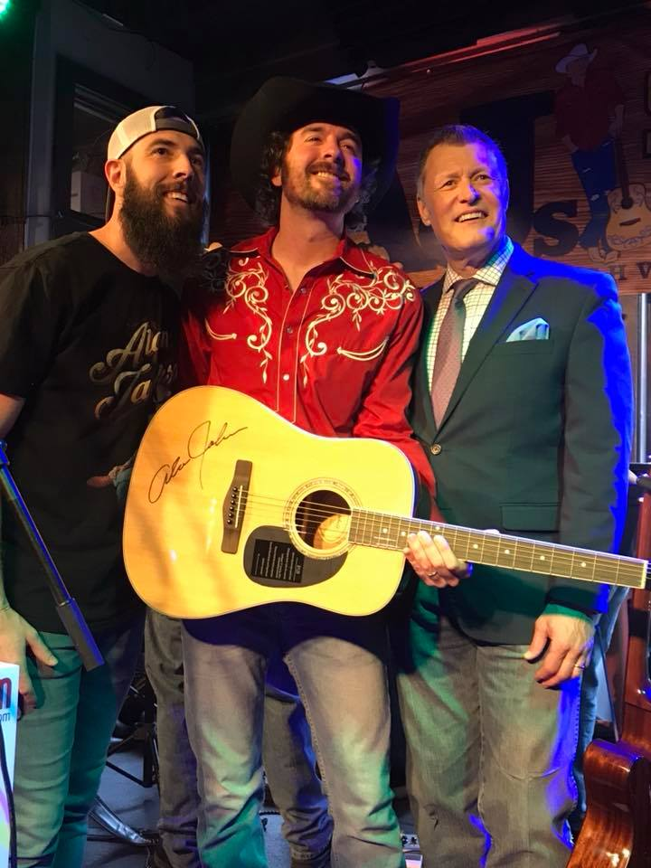 James was presented with a guitar autographed by Alan Jackson. Pictured with Matt Harville, Manager of AJ's Good TIme Bar and Bill Cody, WSM Radio Host.