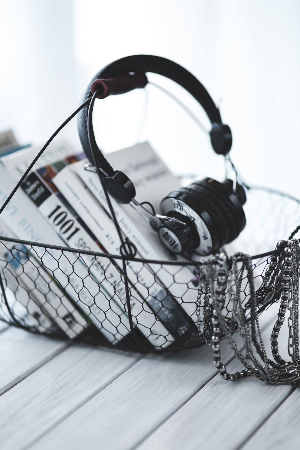 kaboompics_Headphones with a basket of books.jpg