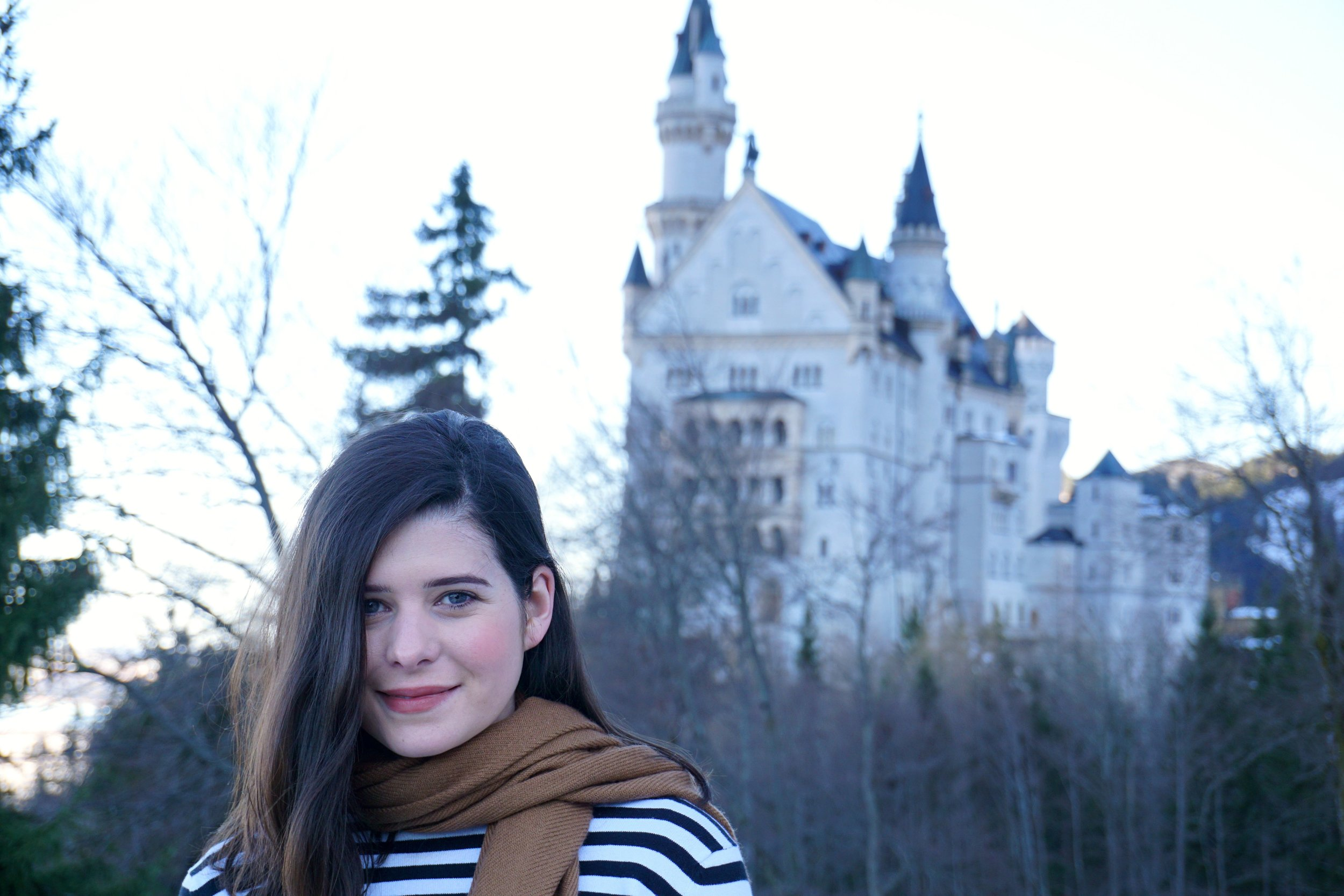 Alice in front of Neuschwanstein Castle in Germany