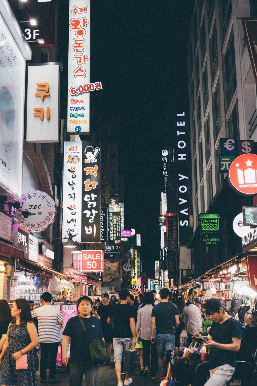 The Myeongdong neighbourhood at night, buzzing.