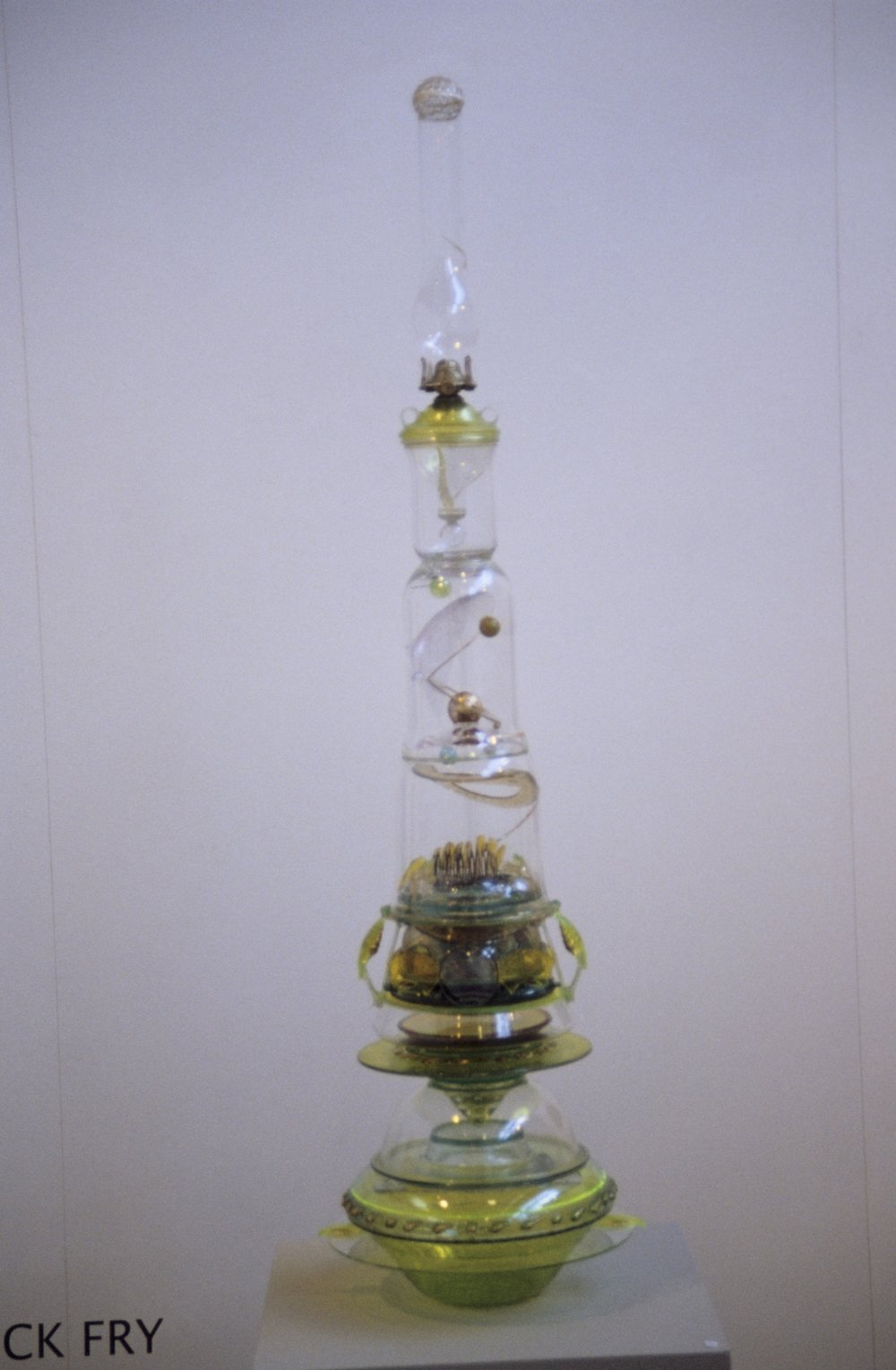 Cosmos, 2009-10, Oil lamp – mixed media, 31 x 135 x 35 cm