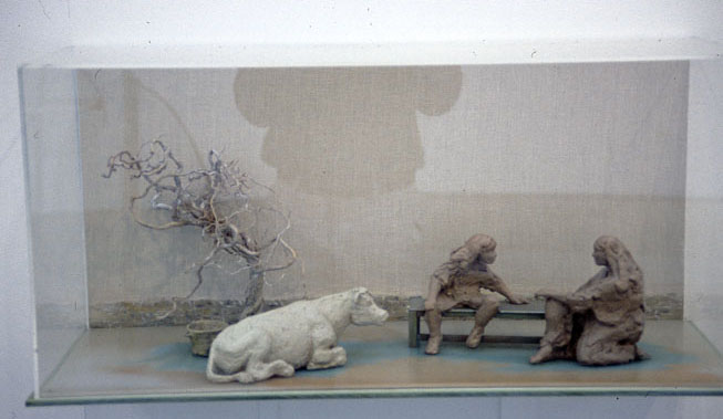 Mother, boy and cow, 2002 – 03, painted sundried clay & wood, 38 x 80x 31 cm