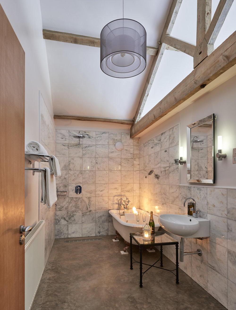 Folly Gill Bathroom: Marble tiles, roll top bath and a walk in rain shower
