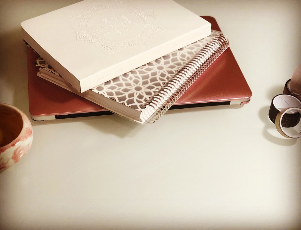 Laptop and planners by Aaron Clay
