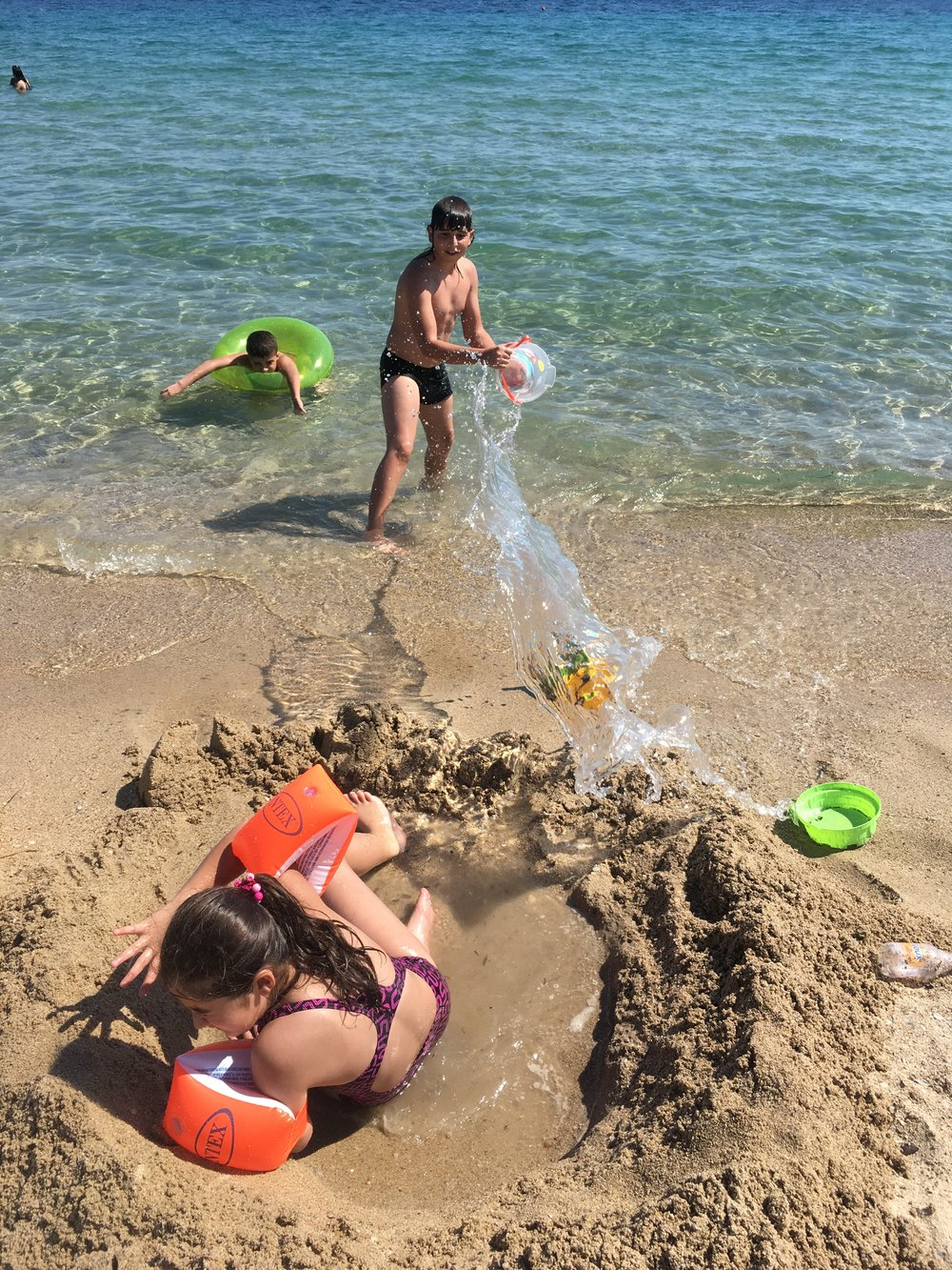 The kids usually play for a full four hours and never leave the sea. Except for water fights  and sand castle building.
