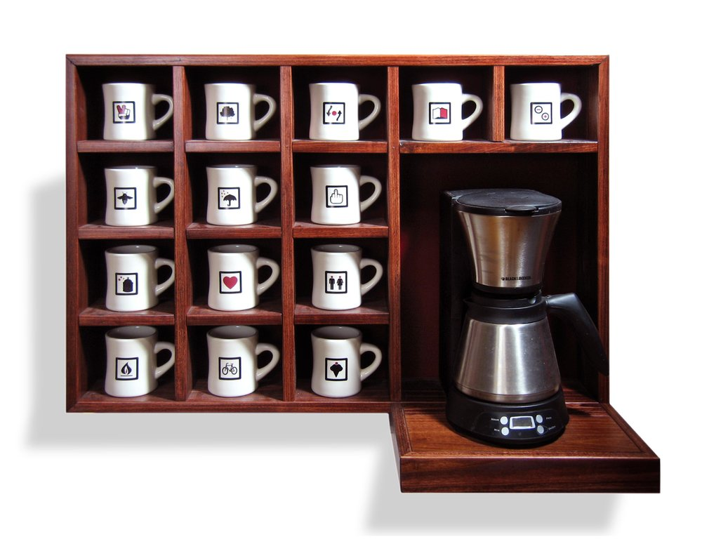 A New Foreign Policy   Mixed Media Installation: Cabinet with coffee maker and mugs 34.5in x 25in x 14in deep