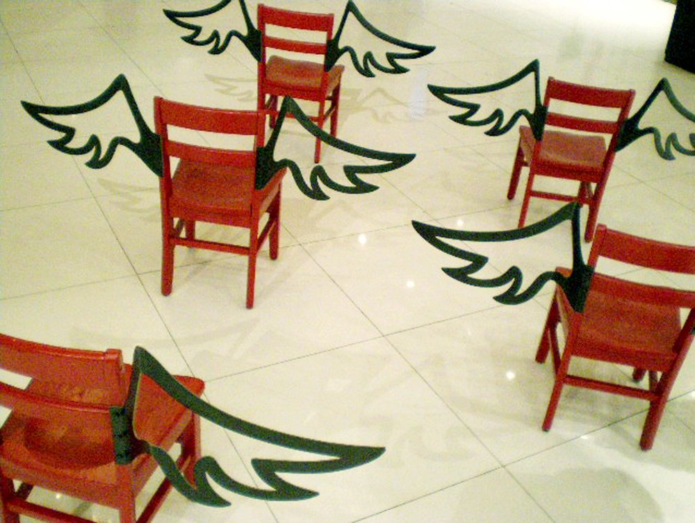 Good Intentions Aren't Enough   Mixed Media Installation: Wooden chairs and fabricated steel wings 44in x 26.5in x 14in deep